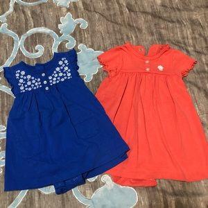 2 Carters onesie dresses.